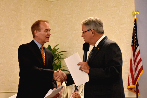 Asbestos attorney John Herrick shaking hands with Charleston Mayor John Tecklenburg